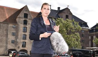 "Denmark's Prime Minister Mette Frederiksen makes a comment about US President's cancellation of his scheduled State Visit, in front of the State Department in Copenhagen, Wednesday, Aug. 21, 2019.  U.S. President Trump announced his decision to postpone a visit to Denmark by tweet on Tuesday Aug. 20, 2019, after Danish Prime Minister Mette Frederiksen dismissed the notion of selling Greenland to the U.S. as ""an absurd discussion.""  (Mads Claus Rasmussen / Ritzau Scanpix)"
