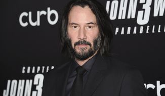 """FILE - In this May 9, 2019 file photo, actor Keanu Reeves attends the world premiere of """"John Wick: Chapter 3 - Parabellum"""" at One Hanson in New York. Reeves and Lana Wachowski are returning to the world of """"The Matrix."""" Warner Bros. Pictures Group chairman Toby Emmerich says Tuesday, Aug. 20, 2019, that a fourth """"Matrix"""" is in the works. (Photo by Evan Agostini/Invision/AP, File)"""