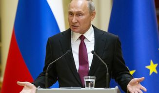 Russian President Vladimir Putin speaks during a news conference after his meeting with President of the Republic of Finland Sauli Niinisto at the President's official residence Mantyniemi in Helsinki, Finland, Wednesday, Aug. 21, 2019. Putin has warned opposition protesters that they must abide by the law or face the consequences. (AP Photo/Alexander Zemlianichenko, Pool)