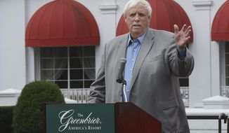 FILE - In this July 7, 2016 file photo Jim Justice, owner of The Greenbrier Resort, speaks to members of Team Greenbrier during a news conference in front of the hotel in White Sulphur Springs W.Va. Can Gov. Jim Justice be forced to live in the state capital? A persistent lawsuit seeking to do just that is heading back to court. A hearing in the case brought by Democratic Del. Isaac Sponaugle is scheduled for Wednesday, Aug. 21, 2019 in Charleston. Justice has acknowledged that he lives in Lewisburg, a city about 100 miles (160 kilometers) from the governor's mansion in Charleston but not far from The Greenbrier, a lavish resort he owns that hosts a PGA tour and has been the site of an annual congressional getaway. (Rick Barbero/The Register-Herald via AP, file)