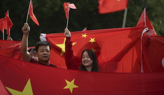 "Chinese Communist Party guidelines dated June 12 ""forbid any positive reports on the Hong Kong people's appeals for democracy and freedom."" (Associated Press/File)"