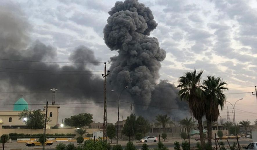 In this Monday, Aug. 12, 2019, file photo, plumes of smoke rise after an explosion at a military base southwest of Baghdad, Iraq. A fact-finding committee appointed by the Iraqi government to investigate a massive munitions depot explosion near the capital Baghdad has concluded that the blast was the result of a drone strike. A copy of the report was obtained by The Associated Press Wednesday, Aug. 21, 2019. (AP Photo/Loay Hameed, File)