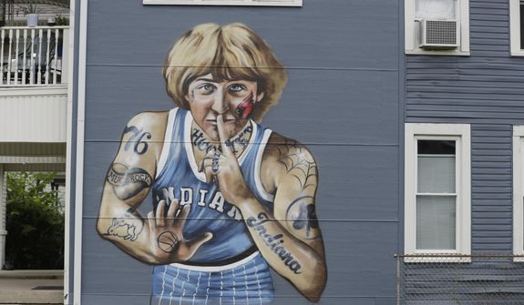 "A mural of former NBA star Larry Bird is seen on the side of a multi-family residence in Fountain Square, Wednesday, Aug. 21, 2019, in Indianapolis. Larry Bird likes the mural but not the tatts. Bird's attorney, Gary Sallee, says the former Indiana Pacers executive ""needs to protect"" his brand and ""doesn't want to be seen as a tattooed guy."" Artist Jules Muck says she was just trying to be funny. The mural is a replica of Bird's appearance on a 1977 Sports Illustrated cover when he played college ball for Indiana State. (AP Photo/Darron Cummings)"