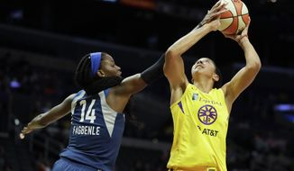 Minnesota Lynx center Temi Fagbenle, left, blocks a shot by Los Angeles Sparks forward Candace Parker during the second half of a WNBA basketball game in Los Angeles, Tuesday, Aug. 20, 2019. (AP Photo/Chris Carlson)
