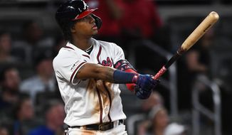 Atlanta Braves' Ronald Acuna Jr. watches his two-run home run ball fly over center field in the fifth inning of a baseball game against the Miami Marlins, Wednesday, Aug. 21, 2019, in Atlanta. (AP Photo/John Amis)