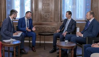 """In this photo released by the Syrian official news agency SANA, Syrian President Bashar Assad, second right, meets with a Russian delegation in Damascus, Syria, Tuesday, Aug. 20, 2019. Assad said his forces' recent victories in the northwestern province of Idlib """"show the determination of the people and the army to strike terrorists, until all parts of Syria are liberated."""" (SANA via AP)"""