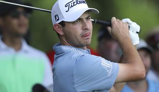 Patrick Cantlay tees off on the 10th hole during practice for the Tour Championship golf tournament in Atlanta, Wednesday, Aug. 21, 2019.  (Curtis Compton/Atlanta Journal-Constitution via AP)