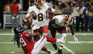 Atlanta Falcons defensive end Adrian Clayborn (99) tackles Washington Redskins quarterback Case Keenum (8) during the first half an NFL preseason football game, Thursday, Aug. 22, 2019, in Atlanta. (AP Photo/Andrea Smith)