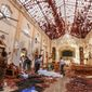 Dead bodies of victims lie inside St. Sebastian's Church damaged in blast in Negombo, north of Colombo, Sri Lanka, Sunday, April 21, 2019.  More than two hundred people were killed and hundreds more injured in eight blasts that rocked churches and hotels in and just outside Sri Lanka's capital on Easter Sunday. (AP Photo/Chamila Karunarathne)