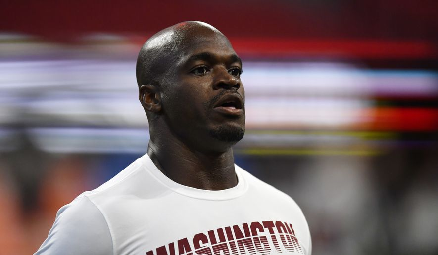 Washington Redskins running back Adrian Peterson warms up before the first half an NFL preseason football game against the Atlanta Falcons, Thursday, Aug. 22, 2019, in Atlanta. (AP Photo/Mike Stewart) ** FILE **