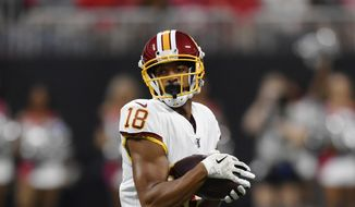 Washington Redskins wide receiver Josh Doctson (18) makes a catch against the Atlanta Falcons during the first half an NFL preseason football game, Thursday, Aug. 22, 2019, in Atlanta. (AP Photo/Mike Stewart) **FILE**