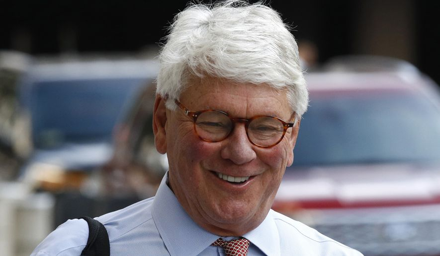 Greg Craig, former White House counsel to former President Barack Obama, walks into a federal courthouse for his trial, Thursday, Aug. 22, 2019, in Washington. (AP Photo/Patrick Semansky)