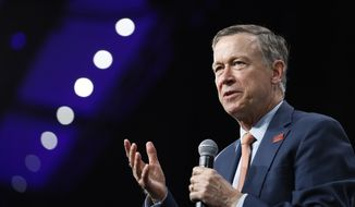 In this Aug. 10, 2019, file photo, then-Democratic presidential candidate former Colorado Gov. John Hickenlooper speaks at the Presidential Gun Sense Forum, in Des Moines, Iowa. Former Colorado Gov. Hickenlooper said Thursday, Aug. 22, that he will run for the U.S. Senate, becoming the immediate front-runner in a crowded Democratic field vying for the right to challenge Republican incumbent Cory Gardner. (AP Photo/Charlie Neibergall, File) **FILE**
