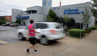 FILE - In this June 21, 2019 file photo, a motorist enters Planned Parenthood of the St. Louis Region and Southwest Missouri. Abortion-rights advocates are suing following a failed attempt to put new Missouri abortion restrictions to a public vote. No Bans on Choice and the state's American Civil Liberties Union sued Republican Secretary of State Jay Ashcroft Thursday, Aug. 22. The plaintiffs' attorneys say Missouri laws and Ashcroft's actions denied advocates of their right to referendum. (Christian Gooden/St. Louis Post-Dispatch via AP, File)