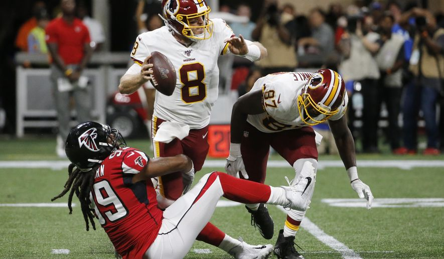 Atlanta Falcons defensive end Adrian Clayborn (99) tackles Washington Redskins quarterback Case Keenum (8) during the first half an NFL preseason football game, Thursday, Aug. 22, 2019, in Atlanta. (AP Photo/Andrea Smith) ** FILE **