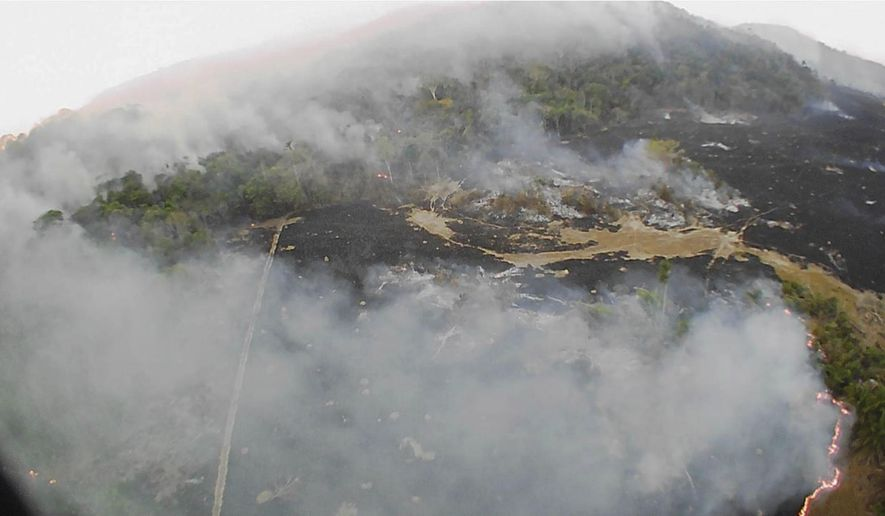 In this Aug. 20, 2019, drone photo released by the Corpo de Bombeiros de Mato Grosso, brush fires burn in Guaranta do Norte municipality, Mato Grosso state, Brazil. Brazil's National Institute for Space Research, a federal agency monitoring deforestation and wildfires, said the country has seen a record number of wildfires this year. (Corpo de Bombeiros de Mato Grosso via AP)