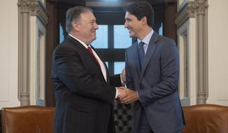 Canadian Prime Minister Justin Trudeau meets with U.S. Secretary of State Mike Pompeo on Parliament Hill in Ottawa, Thursday Aug. 22, 2019.  (Adrian Wyld/The Canadian Press via AP)