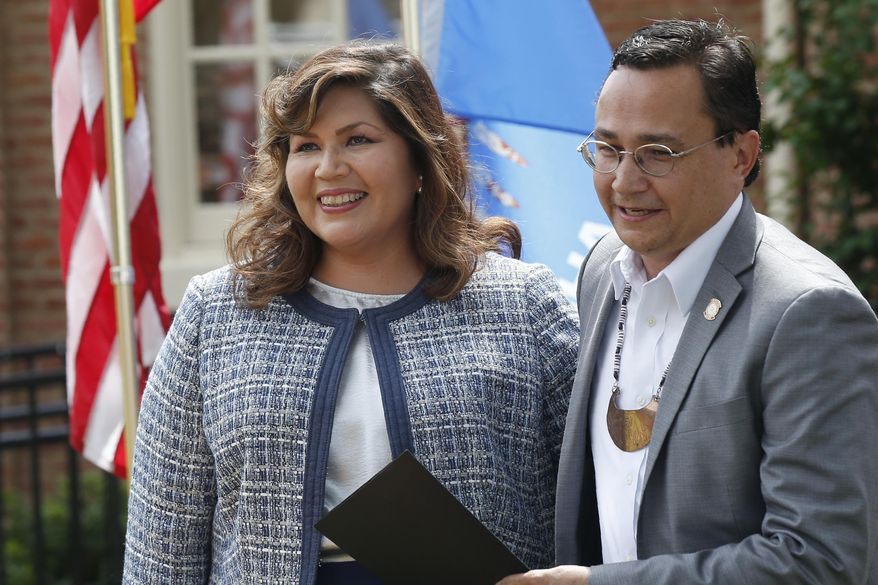 Cherokee Nation Principal Chief Chuck Hoskin Jr., right, stands with Kimberly Teehee, left, after his announcement that he is nominating Teehee as a Cherokee Nation delegate to the U.S. House, in Tahlequah, Okla., Thursday, Aug. 22, 2019. Hoskin Jr. acknowledged the first such attempt by a tribal nation will take time as well as cooperation from Congress. (AP Photo/Sue Ogrocki)