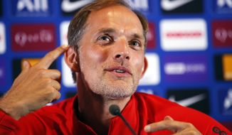 FILE - In this file photo dated Saturday, Aug. 10, 2019, PSG's head coach Thomas Tuchel attends a press conference after a training session at Camp des Loges in Saint Germain en Laye, outside Paris, France. Paris Saint-Germain coach Thomas Tuchel is already searching for answers Thursday Aug, 22, 2019, just two games into the league season. (AP Photo/Francois Mori, FILE)