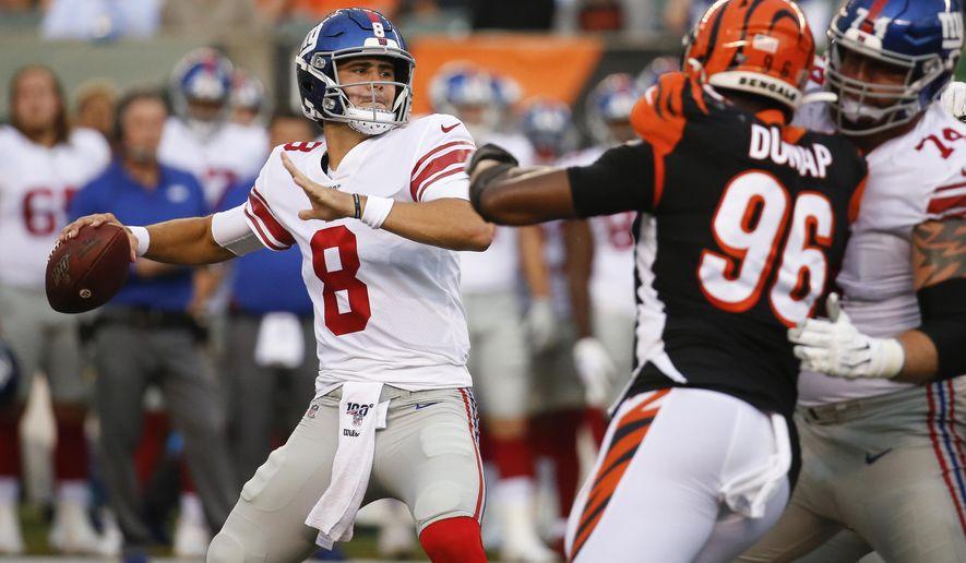 New York Giants quarterback Daniel Jones (8) looks for a receiver during the first half of the team's NFL preseason football game against the Cincinnati Bengals, Thursday, Aug. 22, 2019, in Cincinnati. (AP Photo/Frank Victores)