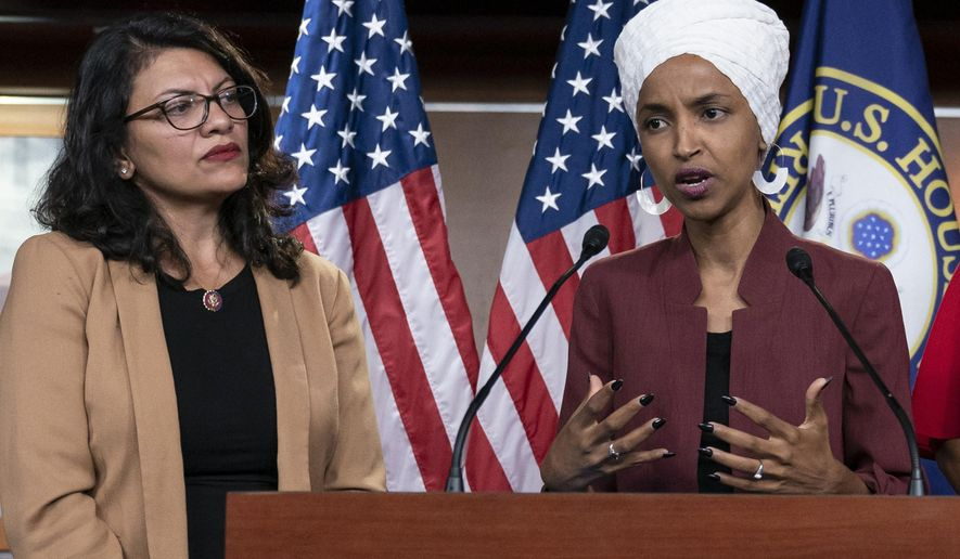 In this July 15, 2019, file photo, U.S. Rep. Ilhan Omar, D-Minn, right, speaks, as U.S. Rep. Rashida Tlaib, D-Mich. listens, during a news conference at the Capitol in Washington. (AP Photo/J. Scott Applewhite, File)