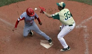 Japan's Yuto Misaki (18) scores on a wild throw by South Korea's Gibeom Jung (35) during the fourth inning of a baseball game at the Little League World Series tournament in South Williamsport, Pa., Wednesday, Aug. 21, 2019. Japan won 7-2. (AP Photo/Gene J. Puskar)