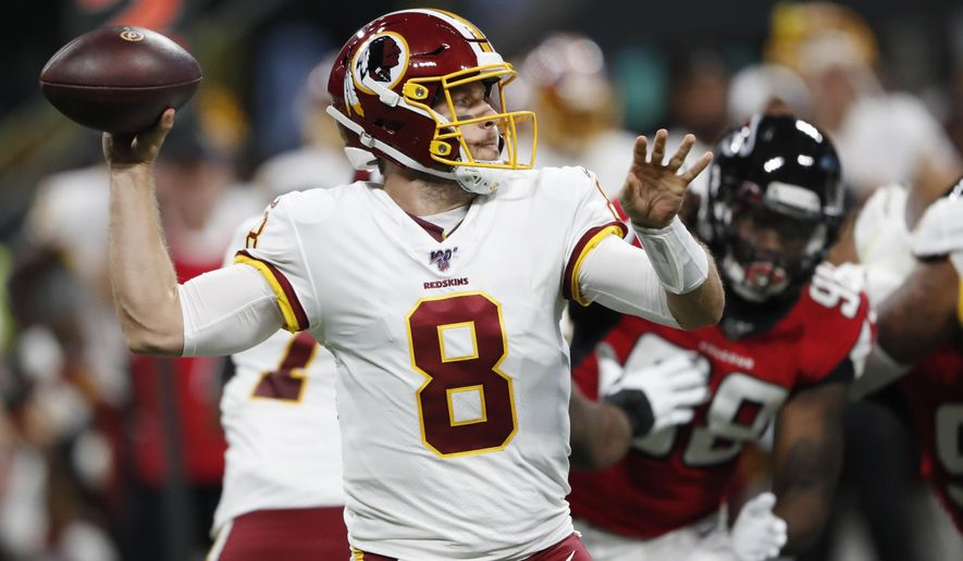 Washington Redskins quarterback Case Keenum (8) works in the pocket against the Atlanta Falcons during the first half an NFL preseason football game, Thursday, Aug. 22, 2019, in Atlanta. (AP Photo/John Bazemore)