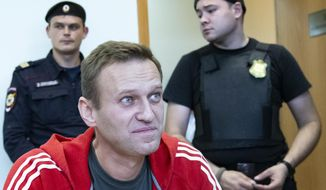 Russian leader Alexei Navalny speaks to the media prior to a court session in Moscow, Russia, Thursday, Aug. 22, 2019. Navalny is due in court, where a judge will consider extending his detention in lieu of days spent in hospital, where he was being treated for an allergic attack at the end of July. Navalny was due to be released on Friday after serving 30 days for calling an unsanctioned protest. (AP Photo/Alexander Zemlianichenko)