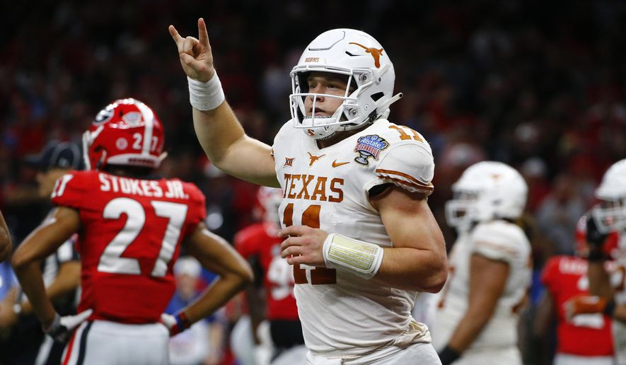 """FILE - In this Tuesday, Jan. 1, 2019 file photo, Texas quarterback Sam Ehlinger (11) celebrates his second touchdown carry in the first half of the Sugar Bowl NCAA college football game against Georgia in New Orleans. The hits came at Sam Ehlinger from just about every angle this summer. Baker Mayfield jabbed him first. Then Terry Bradshaw landed one. Texas' junior quarterback didn't seem to mind, and will likely care even less every time he gets to flash a """"Hook'em horns"""" hand sign after scoring a touchdown. Which he does a lot. Ehlinger and the Longhorns are expected to again challenge for the Big 12 title in 2019. (AP Photo/Butch Dill, File)"""