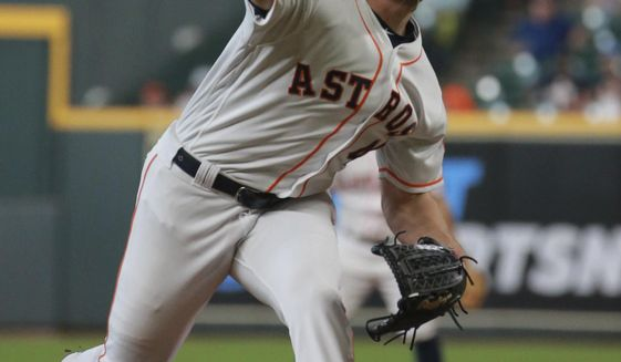 Houston Astros' Gerrit Cole delivers a pitch against the Detroit Tigers in the first inning of a baseball game Thursday, Aug. 22, 2019, in Houston. (AP Photo/Richard Carson)
