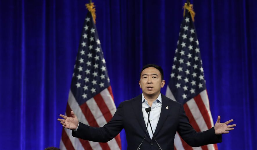 Democratic presidential candidate Andrew Yang gestures while speaking at the Democratic National Committee's summer meeting Friday, Aug. 23, 2019, in San Francisco. (AP Photo/Ben Margot) ** FILE **