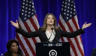 Marianne Williamson, 2020 Democratic presidential hopeful, gestures while speaking at the Democratic National Committee's summer meeting Friday, Aug. 23, 2019, in San Francisco. More than a dozen Democratic presidential hopefuls are making their way to California to curry favor with national party activists from around country. Democratic National Committee members will hear Friday from top contenders, including Elizabeth Warren, Kamala Harris and Bernie Sanders. (AP Photo/Ben Margot)