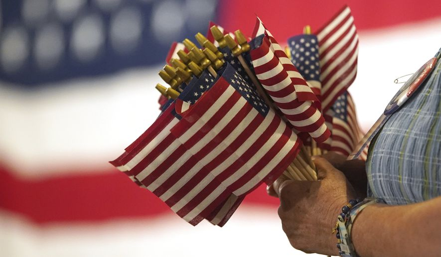 """""""The values that Americans say define the national character are changing, as younger generations rate patriotism, religion and having children as less important to them than did young people two decades ago,"""" stated The Wall Street Journal.  (AP Photo/Mary Schwalm)"""