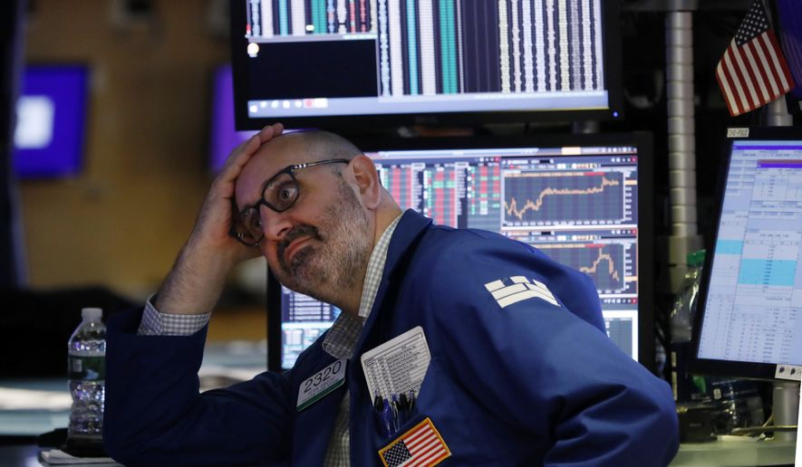 "Specialist Peter Giacchi works on the floor of the New York Stock Exchange, Friday, Aug. 23, 2019. Stocks tumbled on Wall Street after President Donald Trump said he ""hereby ordered"" U.S. companies to consider alternatives to doing business in China. (AP Photo/Richard Drew)"