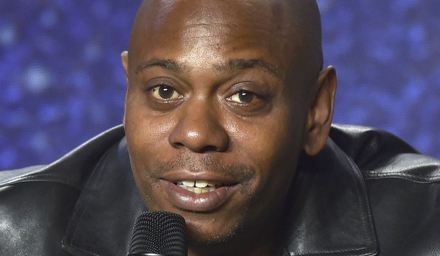 FILE - In this Sept. 9, 2018 file photo, Dave Chappelle speaks at the press conference at the Toronto International Film Festival at the TIFF Bell Lightbox in Toronto. Chappelle plans to host a special block party and benefit concert in southwest Ohio for those affected by the recent mass shooting. Chappelle will be among national and local entertainers planned for the main stage at the Gem City Shine event in Dayton on Sunday, Aug. 25, 2019.(Photo by Evan Agostini/Invision/AP, File)