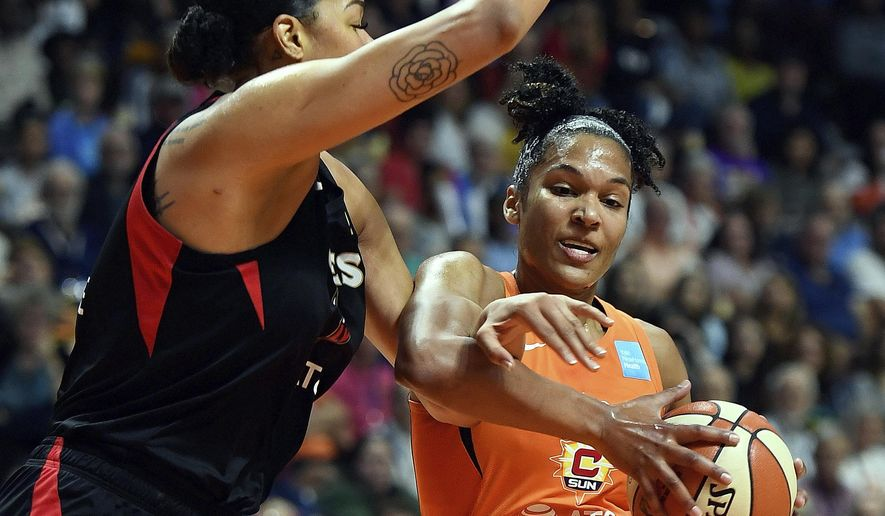 Connecticut Sun forward Alyssa Thomas, right, is fouled by Las Vegas Aces center Liz Cambage during a WNBA basketball game Friday, Aug. 23, 2019, in Uncasville, Conn. (Sean D. Elliot/The Day via AP)