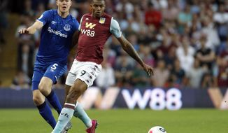 Aston Villa's Wesley, right, and Everton's Michael Keane run for the ball during the English Premier League soccer match between Aston Villa and Everton at Villa Park in Birmingham, England, Friday, Aug. 23, 2019. (AP Photo/Rui Vieira)