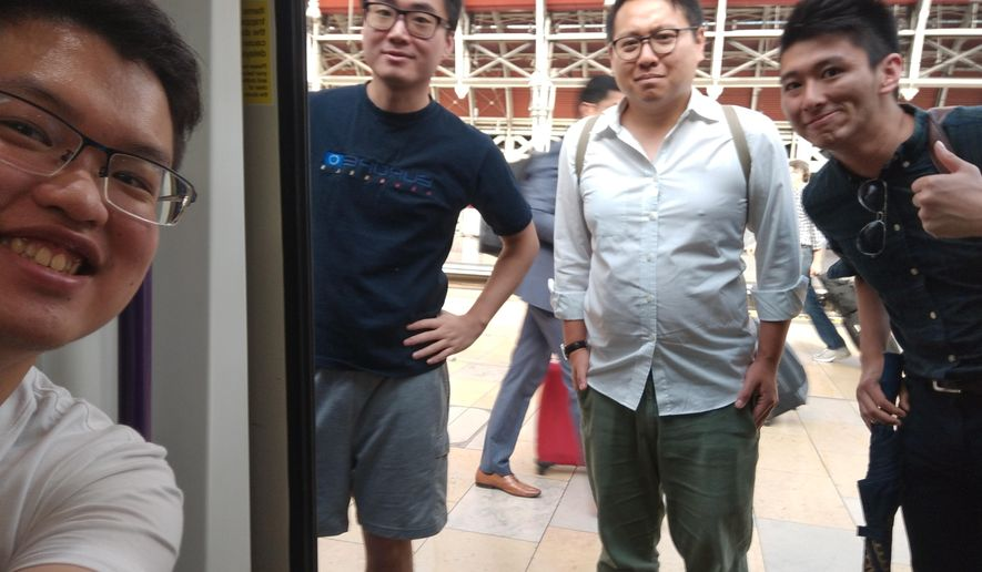 This photo provided by Wilson Li shows Simon Cheng Man-kit, second from left, a resident of Hong Kong. China said Wednesday, Aug. 21, 2019, Cheng, a staffer at the British consulate in Hong Kong, has been given 15 days of administrative detention in the neighboring mainland city of Shenzhen for violating regulations on public order. The case is stoking fears that Beijing is extending its judicial reach to semi-autonomous Hong Kong.  (Wilson Li via AP)