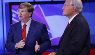 Lt. Gov. Tate Reeves, left, answers a question as his GOP gubernatorial runoff opponent former Mississippi Supreme Court Chief Justice Bill Waller Jr., listens during their televised debate in Jackson, Miss., Wednesday, Aug. 21, 2019. (AP Photo/Rogelio V. Solis)