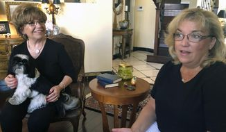 """Terrie Dietrich, left, and her daughter Erin Cross, talk in Dietrich's home in Henderson, Nev., Thursday, Aug. 22, 2019. """"Medicare for All"""" remains hugely popular, but majorities say they'd prefer building on """"Obamacare"""" to expand coverage instead of a new government program that replaces America's mix of private and public insurance. Democrat Dietrich, 74, has Medicare and supplements that with private insurance, an arrangement she said she's pretty comfortable with. Cross, 54, also a Democrat, said she's not comfortable with switching to a system where a government plan is the only choice.  (AP Photo/Michelle L. Price)"""