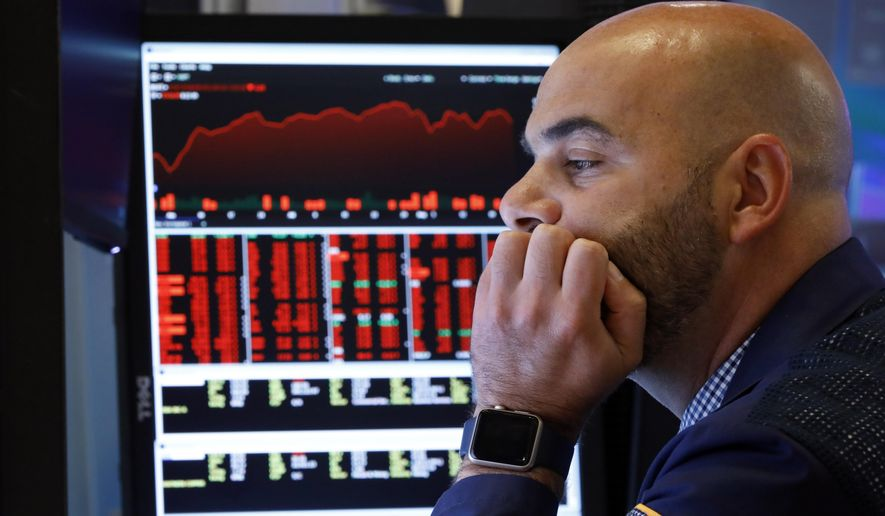 """Trader Fred DeMarco works on the floor of the New York Stock Exchange, Friday, Aug. 23, 2019. Stocks tumbled on Wall Street after President Donald Trump said he """"hereby ordered"""" U.S. companies to consider alternatives to doing business in China. (AP Photo/Richard Drew)"""