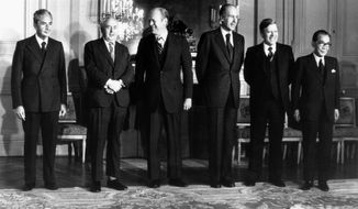 FILE - In this Nov. 17, 1975 file photo the six heads of state and government attending Economic and Monetary summit meeting at the Chateau de Rambouillet, West of Paris, pose for a group portrait before the final session. From left: Premier Aldo Moro of Italy, Premier Harold Wilson of the Great Britain, President Gerald Ford of the United States, President Valery Giscard d'Estaing of France, Chacellor Helmut Schmidt of West Germany and Premier Takeo Miki of Japan. The G7 was originally a response by leaders of Western democracies to the economic shocks and recession of the mid-1970s. (AP Photo, File)