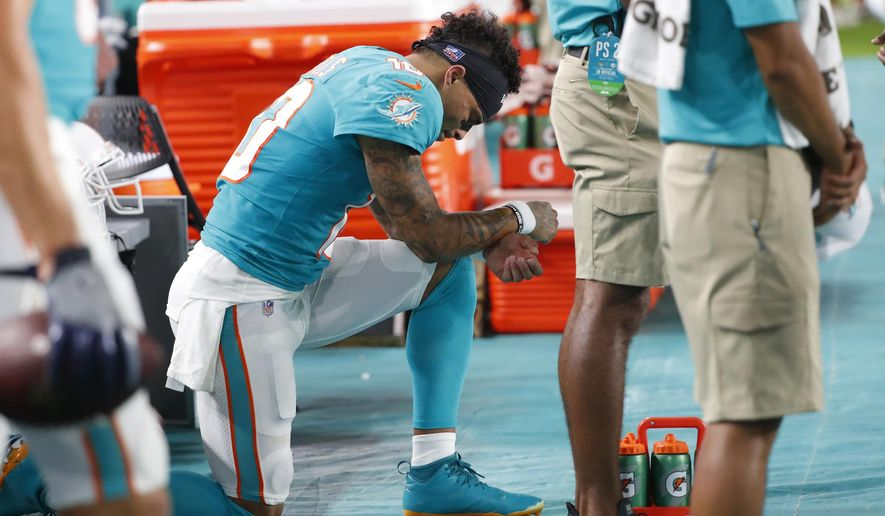 77a6f4d1 Dolphins' Flores says he supports player protest movement ...