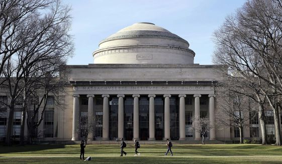 "In this April 3, 2017, file photo, students walk past the ""Great Dome"" atop Building 10 on the Massachusetts Institute of Technology campus in Cambridge, Mass. (AP Photo/Charles Krupa, File)"
