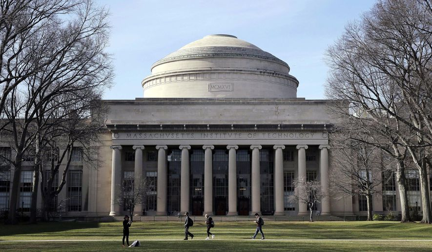"""In this April 3, 2017, file photo, students walk past the """"Great Dome"""" atop Building 10 on the Massachusetts Institute of Technology campus in Cambridge, Mass. (AP Photo/Charles Krupa, File)"""