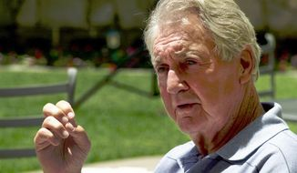 FILE - In this July 24, 2000, file photo, Pat Summerall, lead play-by-play announcer for the NFL on Fox Sports, announces his retirement during a news conference in the Century City section of Los Angeles. Summerall transitioned from a successful playing career to the booth in the 1960s and became the voice of the NFL. He started off as an analyst and was part of the first Super Bowl. He shifted to a play-by-play role in 1974 at CBS and that is where he really shined. (AP Photo/Nick Ut, File)
