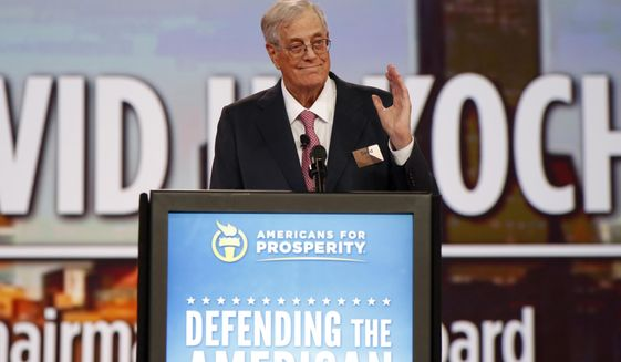 FILE - In this Aug. 1, 2015 file photo, Chairman of the board of Americans for Prosperity David Koch speaks at the Defending the American Dream summit hosted by Americans for Prosperity at the Greater Columbus Convention Center in Columbus, Ohio.  Koch, a major donor to conservative causes and educational groups, has died on Friday, Aug. 23, 2019. He was 79.  (AP Photo/Paul Vernon, File)
