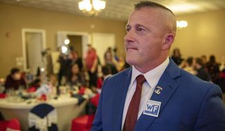 FILE - In this Nov. 6, 2018 file photo, Richard Ojeda, Democratic candidate for West Virginia's 3rd Congressional district, watches election results during his campaign's watch party at Special Occasions in Yuma, near Logan, W.Va  Ojeda says his West Virginia congressional campaign was derailed by a Department of Veterans Affairs employee who's charged with leaking medical records. The former Democratic state senator and one-time presidential hopeful filed suit against the VA on Thursday, Aug. 22, 2019. He's seeking documents relating to the agency's investigation of former claims assistant Jeffery S. Miller. (Dylan Vidovich/The Logan Banner via AP)