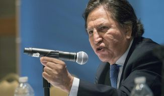 FILE - In this May 24, 2017 file photo, Peru's former President Alejandro Toledo makes an address at the United Nations in New York. Toledo, who was arrested July 16, 2019, has been kept in solitary confinement and only allowed to go to an exercise yard once in the month he has been in U.S. custody while fighting extradition to his native country to face bribery charges, his defense attorney said in court papers seeking for his release on bail. (AP Photo/Mary Altaffer, File)