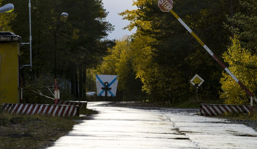 "FILE -  This Sunday, Oct. 7, 2018 file photo, shows an entrance to ""The State Central Navy Testing Range"" near the village of Nyonoksa, northwestern Russia. The Aug. 8, 2019, explosion of a rocket engine at the Russian navy's testing range just outside Nyonoksa led to a brief spike in radiation levels and raised new questions about prospective Russian weapons. Over Russian 100 medical workers who helped treat victims of a recent mysterious explosion at a military testing range have undergone checks and one man has been found with a trace of radiation, officials said Friday Aug. 23, 2019. (AP Photo/Sergei Yakovlev, File)"